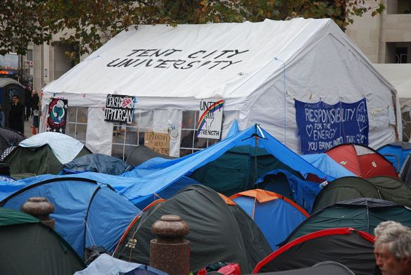 """The 'Tent City University' looms over the Occupy London tents"" from http://commons.wikimedia.org/"
