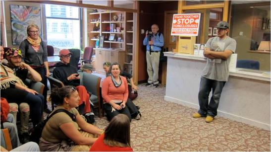 Activists accompany a Cruz family member to the mayor's office on 5/30. Photo by Sara Nelson.