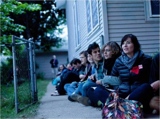 Activists form a human chain around the Cruz family home on 5/30 in the presence of private security hired by Freddie Mac. Photo: Peter Leeman (http://peterleeman.tumblr.com/). Reproduced with permission.