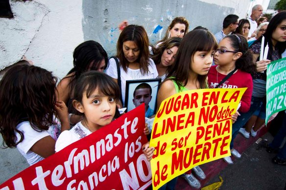 Children gather at the site where José Antonio Elena Rodríguez was killed during a binational protest march, 2 November 2012.  Credit: Murphy Woodhouse.